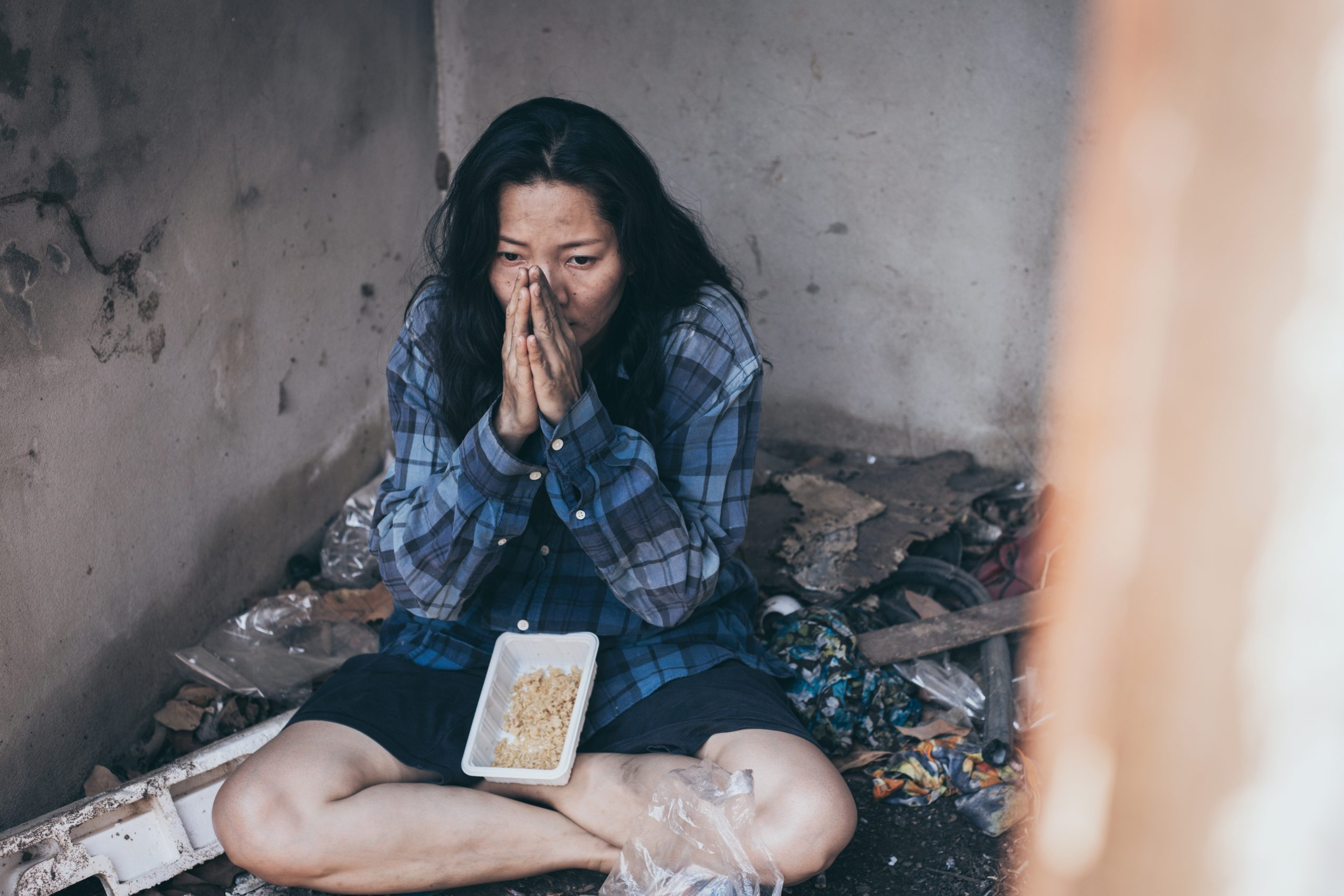 A woman in poverty hungry and devastated