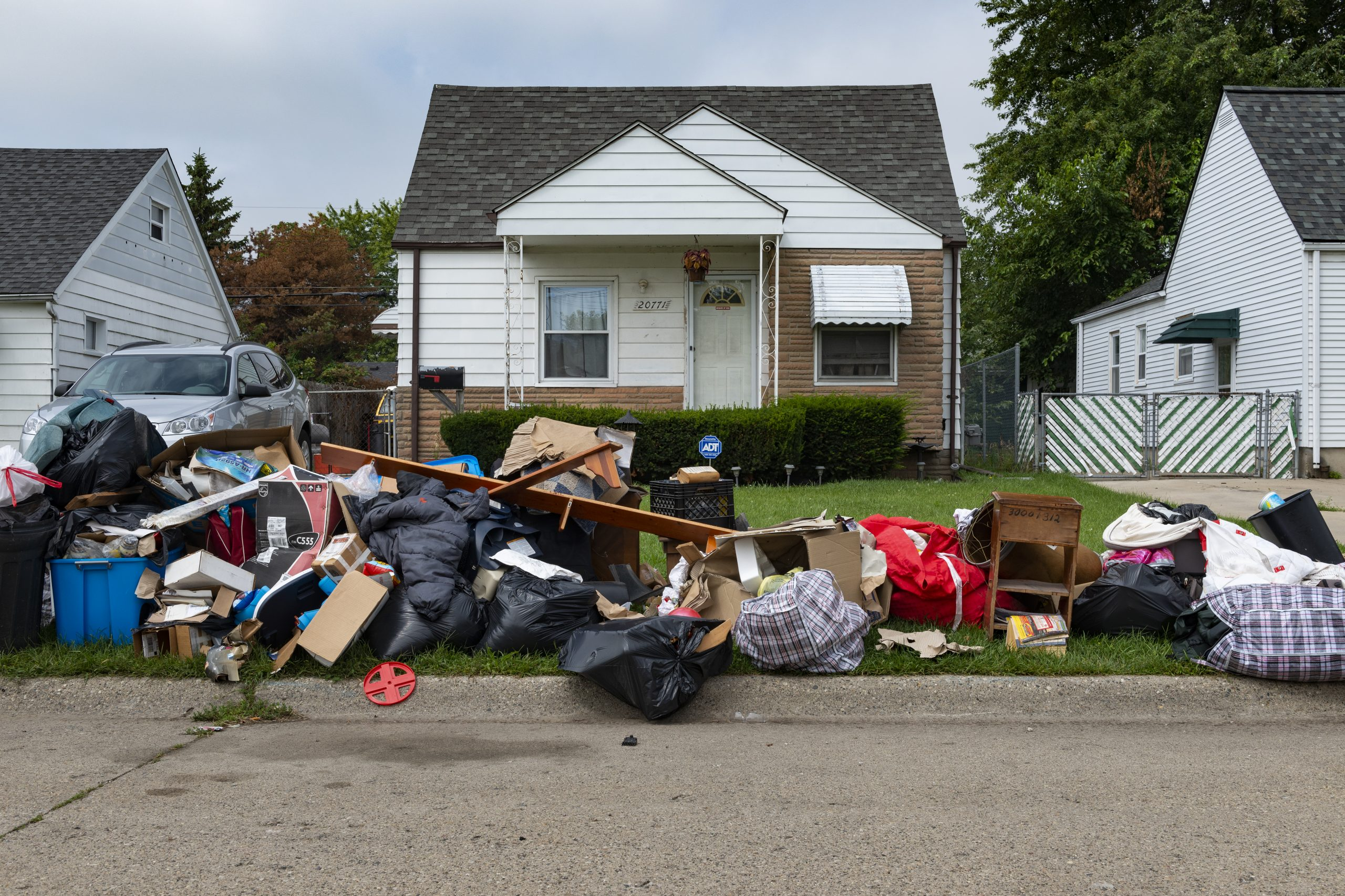 vacant home with evicted tenants' belongings on sidewalk